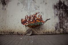 Kutching, the capital of Sarawak State on Borneo Island is found in the wild east of Malaysia - by Ernest Zacharevic (1986), Lithuanian