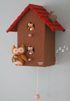 A wonderful baby shower gift! Wooden birdhouse with felt lined. With music box in it (there is a choice of different melodies) .  Mama owl has a baby