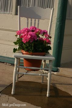 Have an old wooden chair that is a little wobbly? Use it as an old wooden chair flower pot holder.