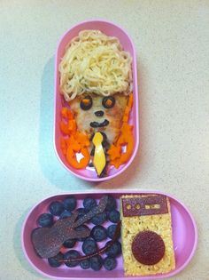 Angel hair pasta, cheese pizza, black olives, cheese tie and carrot stars. Amp rice crispy and guitar fruit roll up on blueberries