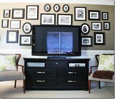 tv wall.. Love the bold black frames with b photos