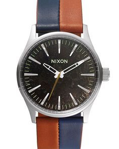 Navy and Brown Sentry 38 Leather Watch by Nixon. Simplicity works wonders. The Sentry 38 Leather offers maximum impact in a discrete format. Reduced in size, it boasts a daring face and real elegance with its subtle proportions http://www.zocko.com/z/JJTNa