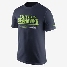 """REPRESENT YOUR TEAM The Nike """"Property Of"""" (NFL Seahawks) Men's T-Shirt features a team logo and print on soft, comfortable cotton for a loyal look and lasting comfort. Product Details Rib crew neck with interior taping Fabric: 100% cotton Machine wash Imported"""