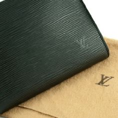 Louis Vuitton Pochette Clutch This 100% Authentic LV clutch is especially chic and classy in black epi leather. A great clutch for day or evening affairs, it features black leather w/gray suede interior & golden brass hardware. Removable single smooth leather strap w/gold leash clip can be attached to another bag. Signature LV initials discreetly stamped on the front. Carry it by hand, elbow, wrist, or shoulder. The elegant gold-tone hardware makes it easy to go with everything! EUC simply…