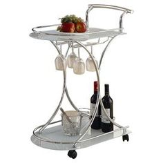 "Serving cart with 2 frosted glass tiers and a wine bottle and stemware rack.     Product: Serving cart    Construction Material: Metal and glass    Color: Chrome   Features:  Wine bottle and stemware rack    Four casters for easy mobility    Two shelves   Dimensions: 32.25"" H x 27"" W x 15.75"" D"