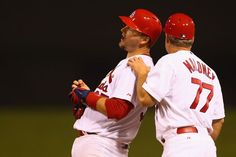 AJ Pierzynski celebrates after singling in the go ahead run in the eighth inning against the Reds. Cards won the game 6-5 in the 10th inning.  8-18-14
