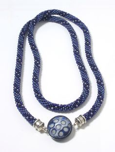 Blue Polymer Disc and Bead Rope Necklace by Dorothy Siemens. 38 inches long.