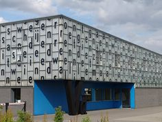 The Veenman Printer building in Ede, Netherlands designed by Neutelings Riedijk. The facade wraps around the building to form a striking display of text. It is made of serigraphed glass and has a text by Dutch poet K. Schippers in a layout designed by Karel Martens.
