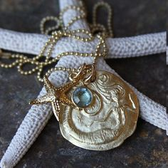 Mermaid gold necklace and pendant: http://www.oceanofferings.com/mermaids.html