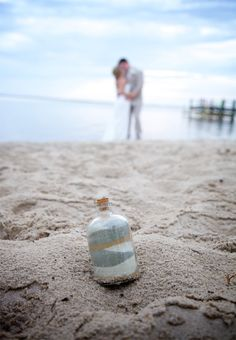 Remember your wedding day with a bit of Outer Banks sand in a bottle. Sarah D'Ambra Photography http://www.outerbanksweddingassoc.org/membersearch/memberpage.html?MID=2135=Photographer=16 #obxwedding #sandinabottle