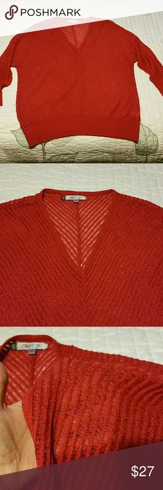 Jennifer Lopez red sparkly sweater Gorgeous!! Excellent used condition. I have only worn it once. V neck. Lightweight so you would have to wear something under it. I tried to show the material and the sparkle in pic 3. Bottom is a bit fitted. 3/4 sleeve. Jennifer Lopez Sweaters