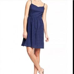 Gap Sun Dress This navy blue dress is so cute. The top layer has the beautiful floral cutout detail. The straps completely untie that way you can adjust to your liking. The side zipper and clasp makes for easy access! GAP Dresses