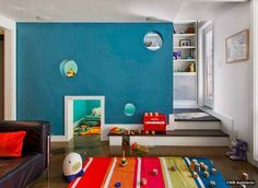 Kids Room: Modern Playroom Ideas Below The Stairs With Blue Wall Theme And Black Sofa With Colorful Rug: Colorful Kids Playroom Design Ideas Diy Casa, Hidden Rooms, Playroom Design, Playroom Ideas, Loft Playroom, Playroom Mural, Daycare Design, Modern Playroom, Colorful Playroom