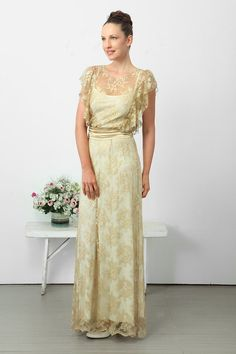 What a lovely draping, gold lace dress!