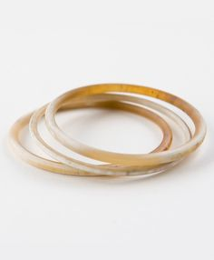 This trio of effortless bangles is hand carved from the horn of the Vietnamese water buffalo. Wear them alone for a more netural look, or throw in our Saigon Color Dipped Bangle for a bold splash of indigo.