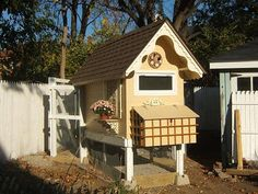 Check out this gorgeous dollhouse coop!