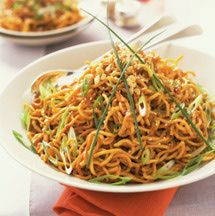 Noodles with peanut sauce is one of my favorite easy dishes to whip up on those nights where I'm very hungry, but just don't feel like cooking. This Thai and Chinese-inspired recipe can be made less spicy by substituting red pepper flakes for the cayenne, or, omit the cayenne altogether.