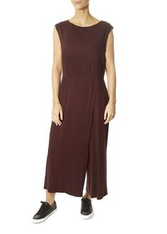 This is the Lightweight Jersey Burgundy Jumpsuit by our friends at Eileen Fisher! A jumpsuit that thinks like a dress: fitted through the bodice with wide legs and a faux-wrap front. Easy, flared lines and the polish of our signature jersey. SHOP NOW! Burgundy Jumpsuit, Womens Jumpsuits, Odd Molly, Eileen Fisher, Wide Leg, Dresses For Work, Skirts, Summer, London