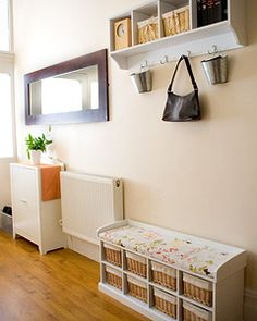 love the little bench with bins and the cute hook-rack with bins, along with the long & narrow mirror to welcome people