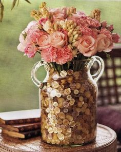 Cheap and easy DIY vase filler = BUTTONS! What a great idea! #weddingideas #centerpieces