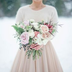 Delicate Winter blooms and this blush @bhldn gown. Are you planning a Winter wedding yet? More on the #celsiablog. Photo by @christiegrahamphotography #winterwedding #bridalbouquet #weddingflowers #gardenrose #weddingideas by celsiafloral