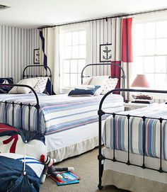 Vintage nautical flags function as clever curtains in this Cape Cod home.