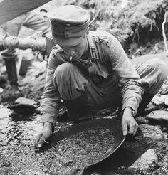 A soldier panning for gold in the Lemmenjoki in Finnish Lapland. Pin by Paolo Marzioli