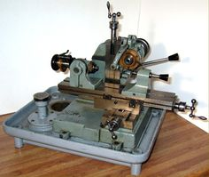 """A beautiful and original Derbyshire Micromill Model 750-S with ball-bearing headstock and cam-operated vertical slide with screw-feed vertical adjustment. The 12-inch table has screw feeds to each axis and the machine is complete with a cutter arbor, overarm support and the rare """"Semi-universal Index Centers"""""""