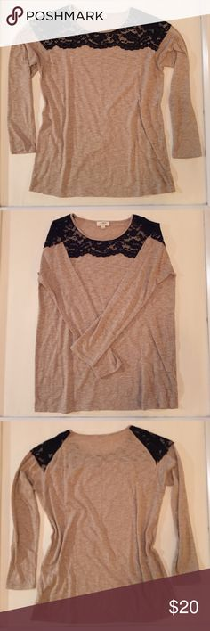 ADORABLE shirt! This shirt is super cute.  It has black lace detail along the neckline. Tops