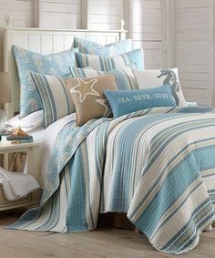 Make your bed more inviting with the stripe details and soft colors of this comfortable cotton quilt set.