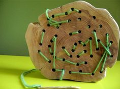 A beautiful twist on sewing or lacing practice. Drill holes in a wood scrap, sand smooth, and use with twine or jute for a Montessori activity with natural materials that will look and feel wonderfully interesting.