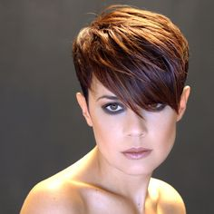 I like this pixie cut on her, but I'd get it with shorter bangs. I can't stand hair in my face.