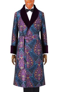 The design of this opulent gown is inspired by William Morris's own, from the Arts and Crafts period. It is rendered in an exquisite, pure English-woven silk in deep navy, rich turquoise and sumptuous purple.  These colours are then picked out in the gown's trims: the hand-quilted purple velvet revers, the two-tone turquoise and magenta satin lining and the corded piping which punctuates the gown throughout.