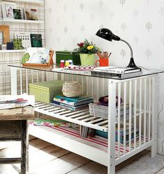 Repurposed crib into a nice desk with organization!