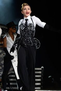 Twenty-Two years after it's inception Jean Paul Gaultier gave his original cone bra corset he made for Madonna's Blond Ambition Tour a makeover for her 2012 MDNA tour. Madonna Vogue, Madonna Fashion, Madonna Costume, Kpop Outfits, Fashion Images, Cone Bra, Hollywood Celebrities, Material Girls, Jean Paul Gaultier