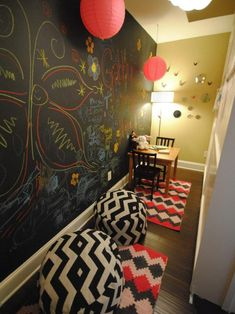 Behind the bookshelves, this secret hiding place in a little girl's playroom is the perfect escape to let creativity run wild. A chalkboard accent wall allows endless possibilities to draw and decorate. Playroom Organization, Playroom Decor, Hidden Rooms In Houses, Passage Secret, Room Under Stairs, Secret Hiding Spots, Rock Room, Stairs In Kitchen, Cool Kids Rooms