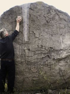 The international artist Pinuccio Sciola playing his famous Sound Stones