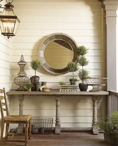 Vignette with topiary and wire accents atop a Twilight Bay Veronica Console Table in Distressed Textured Soft Taupe Gray French Country Sofa, Country Sofas, Outdoor Rooms, Outdoor Living, Indoor Outdoor, Le Cosy, Porch Table, Lexington Home, Modern Home Furniture