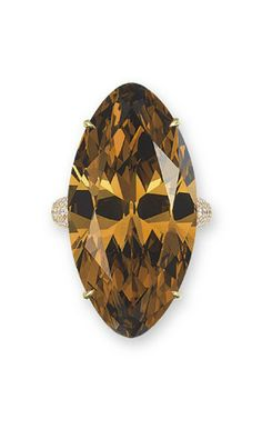 AN IMPORTANT COLOURED DIAMOND AND DIAMOND RING  Set with a marquise-cut fancy deep orange-brown diamond weighing 30.14 carats, to the pavé-set brilliant-cut diamond gallery and half-hoop, mounted in 18k gold