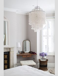 Laura Butler Maddern Interior Design Inspiration | The Maker Place - This serene and glamorous bedroom with delicate chandelier and vintage styling is the perfect place to relax in. Take a look at our interview with designer Laura for more gorgeous room inspiration and her predictions for the key home decor trends for 2018.