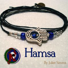 """Thread: BlackColored Glass Beads:Royal Blue Translucent, Crystal, frostedHamsa Hand Amulet:  Tibetan SilverHeishei Beads: Sterling SilverTag: NTIO (brass)Size: Fits AllClose-up Photo: Not Actual SizeA hamsa is an amulet shaped like a hand, with three extended fingers in the middle and a curved thumb or pinky finger on either side. It is thought to protect against the """"evil eye"""" and is a popular motif in both Jewish and Middle Eastern jewelry.Our special """"forever"""" thin chord is color fast and…"""