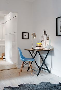 Small studio space, blue chair