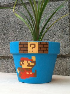 Super Mario Bros Flower Pot - I wish I was more artistic! It's not a fire flower, but it looks cool! Super Mario Bros Flower Pot - I wish I was more artistic! It's not a fire flower, but it looks cool! Flower Pot Crafts, Clay Pot Crafts, Diy Crafts, Super Mario Nintendo, Super Mario Bros, Painted Flower Pots, Painted Pots, Fire Flower, Deco Retro