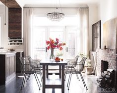 home of actress keri russell.  rustic, traditional, and contemporary all rolled into one.  love the mix of the glamorous chandelier, woods, and wire chairs.