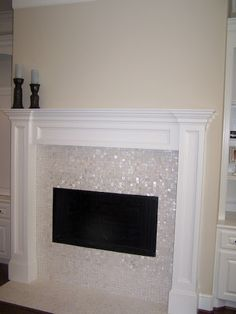 """Fireplace using 1""""x1"""" white mother of pearl tile. https://www.subwaytileoutlet.com/products/White-1x1-Pearl-Shell-Tile.html#.VOUCuPnF-1U"""