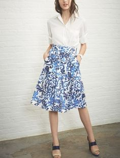 A white button-up shirt pairs well with a floral print skirt.