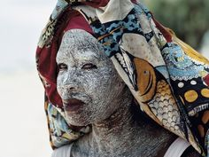 Africa | Cream made from ground bark provides protection from Mozambique's equatorial sun. | © James L. Stanfield