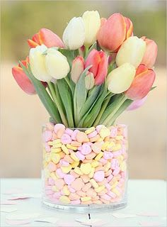Fill a vase with candy hearts & your favorite arrangement of flowers.