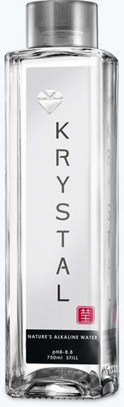 KRYSTAL Alkaline Water in recyclable glass and PET bottles.