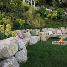 steep grade landscaping - stone seating on the lower bench!